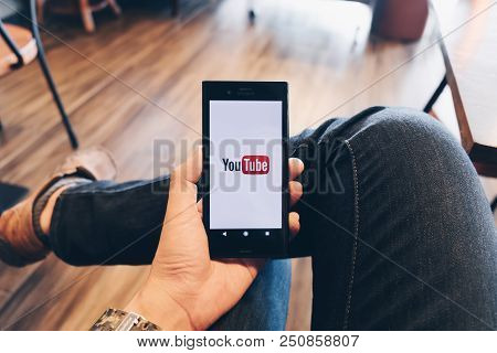 Chiang Mai,thailand - July 07, 2018: A Woman Showing Screen Shot Of Youtube On Sony Mobile Phone You