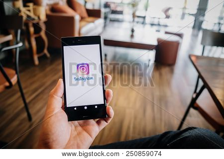 Bangkok,thailand - July 07,2018: Woman Hand Holding Sony Mobile With Instagram Application On The Sc