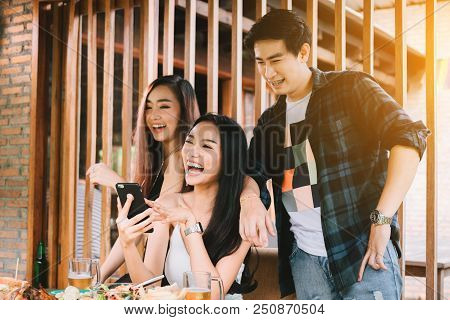 Asian Group People Meeting At Restaurant With Enjoy Laughing Together.