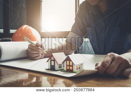 Architect Drawing On Blueprint Architectural, Young Man Working On His Plane Project At Site Constru