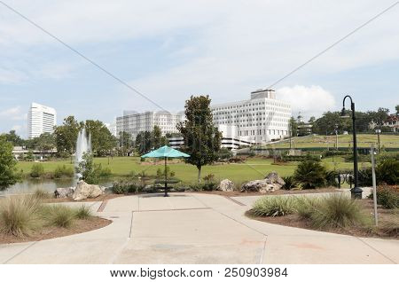 Tallahassee, Fl, Usa - July 15, 2018: Public Cascades Park With A Downtown View Of Tallahassee In Th