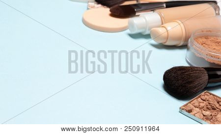 Makeup Background With Free Space For Text. Basic Make Up Products: Primer, Foundation, Powder. Side