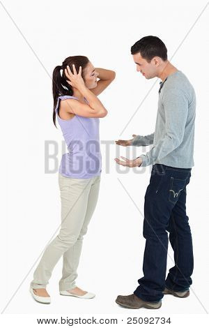 Young couple having an argument against a white background