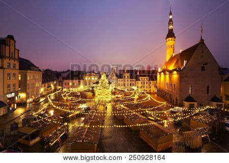 Panoramic View Of Decorated And Illuminated Christmas Tree And Christmas Market At Town Hall Square