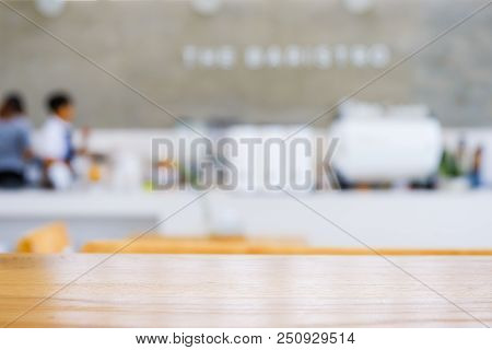 Light Wooden Top Table In Front Of Blurred Background Of Cafe Or Coffee Shop And Bar.the Table For D