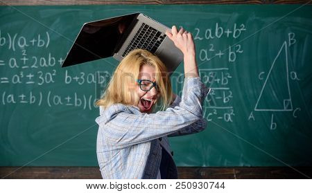 Overstrain of the nervous system. Teacher woman raising laptop above herself ready to destroy. She needs pills to keep calm and mental health. Working conditions of teachers causes nervous disease. poster