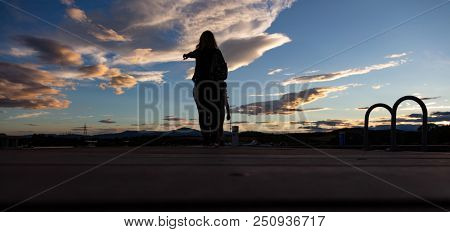 Beauty of sunrise concept. Mother and child and at sunset over mountain range, white clouds, banner, wallpaper.