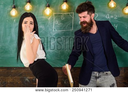 Girl on helpless face punished by teacher. Schoolmaster punishes sexy student with slapping on her buttocks with book. Man with beard slapping sexy student, chalkboard on background. Role game concept poster
