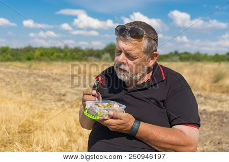 Bearded Senior Is Ready To Healthy Eating (steamed Vegetables) Outdoor