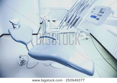 Dental Chair Stands In Office. Different Medical Equipment. Healthcare Concept. Medical And Care. Wo
