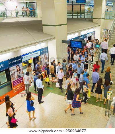 Singapore - Feb 16, 2017: Passengers Living A Mrt Train At A Station. The Mrt Network Encompasses 19