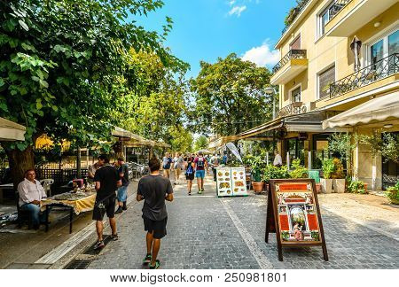 Athens, Greece - September 11 2017: Tourists Walk The Crowded Path Past Cafes, Street Vendors And So