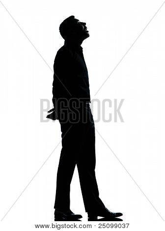 one caucasian business man looking up mouth open  silhouette Full length in studio isolated on white background
