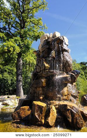 Stone fountain in the park staging