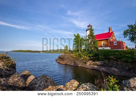 Lighthouse On A Rocky Coast. The Eagle Harbor Lighthouse On The Rocky Shore Of Lake Superior. Eagle