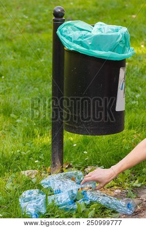 Old Trash Can In Park And Heap Of Plastic Bottles, Concept Of Environmental Protection, Littering Of