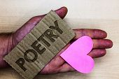 Conceptual hand writing showing Poetry. Business photo text Literary work Expression of feelings ideas with rhythm Poems writing Packing card inscribed text love heart hand recycle make useful poster