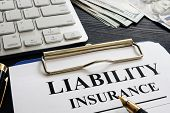 Liability insurance agreement policy on the desk. poster