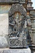 Ornate wall panel reliefs depicting Vishnu as Trivikrama. Ranganayaki, Andal, temple, Chennakesava temple complex, Belur, Karnataka, india. West wall poster