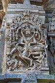 Ornate wall panel reliefs depicting Narsimha, incarnation of Vishnu, south western corner, Chennakesava temple, Belur, Karnataka, india poster