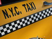 Photo of the door panel of a New York City Yellow Taxi Cab poster