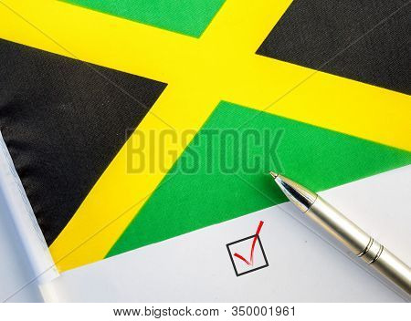 Pencil, Flag Of Jamaica And Check Mark On Paper Sheet