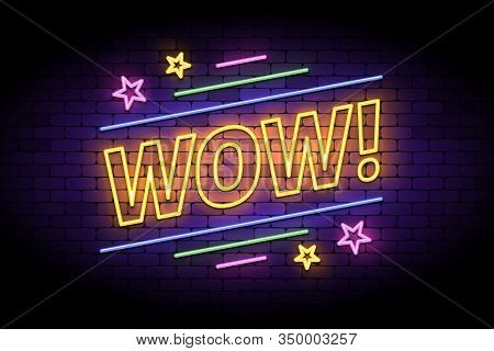 Wow Label In Glowing Neon Style On A Brick Wall. Night Bright Neon Sign With Wow Letters And Stars F