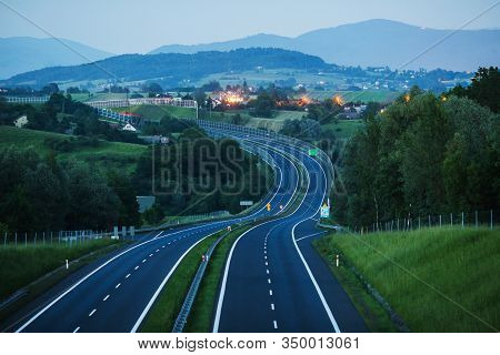 New Empty Highway. Road In Evening. Travel By Car On Highway. Road Markings. Evening Twilight
