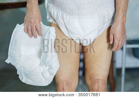 Asian Senior Or Elderly Old Lady Woman Patient Wearing Incontinence Diaper In Nursing Hospital Ward