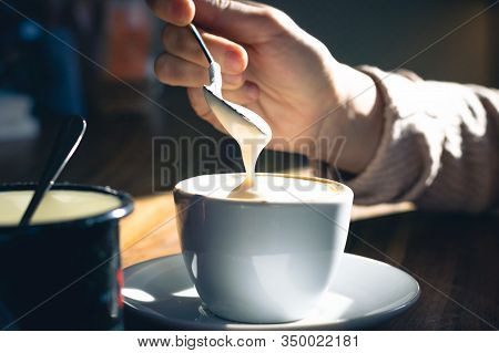 Woman Drinking Espresso Coffee At Cafe Bar. Woman Relaxing In Cafe Bar In Sunlight. Urban Lifestyle.
