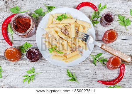 Boiled Penne Pasta Mixed With Stuffing Of Stewed Minced Pork And Fried Onion In Navy-style On White