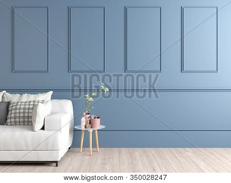 Interior Space Of A Pale Blue Wall With Mouldings Showing Part Of A White Couch And A Small Circular