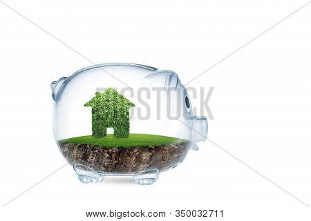 Saving To Buy A House Or Home Savings Concept With Grass Growing In Shape Of House Inside Transparen