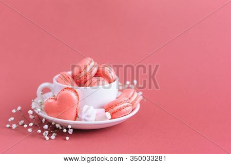 Valentine's Day Background With Pink French Heart-shaped Macarons And Marshmallows. Cup With Macaron