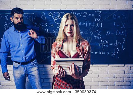 Student Life. Couple Of Man And Woman In Classroom. College Students And Teacher In Love Together. F
