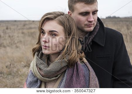 Serious Troubled Couple Standing Close Together Looking Away From Each Other