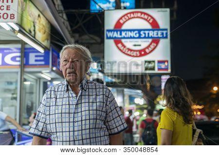 Thailand, Phuket, Patong, February 1, 2020: Gray-haired Elderly European Man, Tourist, Walking Bangl