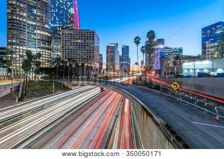 traffic on freeway through modern city at night in los angeles