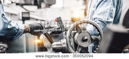 Industrial Concept For Background. Image Of Blur Two Workers Are Working With The Machine. Industria