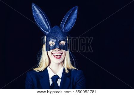 Sexy Model Dressed In Costume Easter Bunny. Pretty Bunny Girl Winking And Tongue Out. Easter Woman W