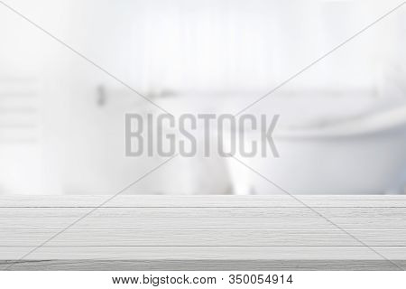 Empty Wooden Top Table With Blurred Bathroom Background.