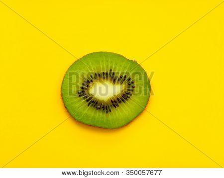 Kiwi Cutaway On A Yellow Background. One Circle Of Kiwi.