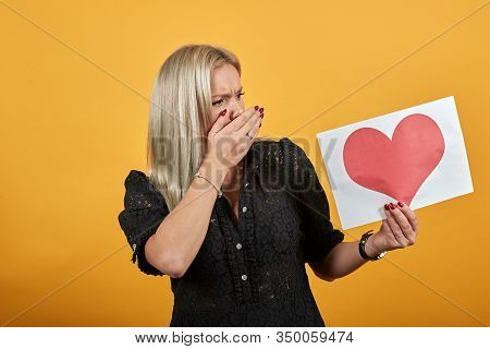Beautiful Blonde Girl In Black Dress On Yellow Background Shocked Nervous Irritated Woman Put Hand O