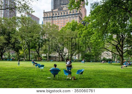 New York, Usa - June 7, 2019: People Rest On The Park Lawn Near The  The East Coast Memorial In Batt