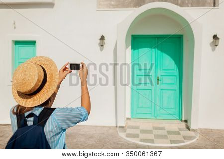 Santorini Traveler Taking Photo Of Doors Architecture In Akrotiri On Smartphone. Tourism, Traveling,
