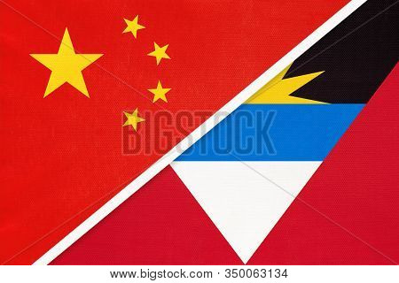 China Or Prc Vs Antigua And Barbuda National Flag From Textile. Relationship Between Asian And Ameri