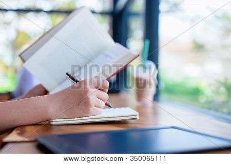 Student  Reading Book And Write On Paper. Relax And Recreation On Holiday At Home. Study And Educati