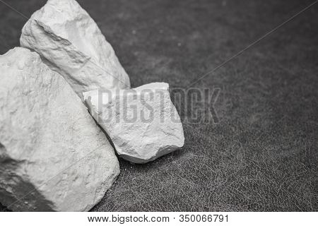 Large Chunks Of White Food Grade Natural Chalk On A Gray Background. Health Care, A Source Of Calciu