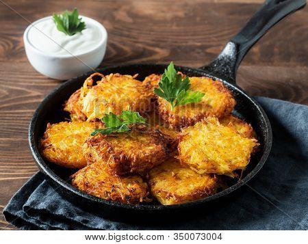 Potatoes Pancakes Latkes, Flapjacks, Hash Brown Or Potato Vada With White Greek Yoghurt Or Sour Crea