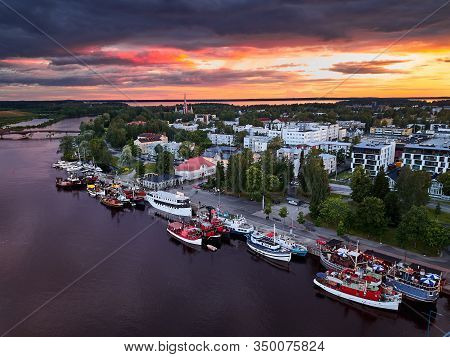 Aerial View Of Retro Steamships At The Pier On The Pielisjoki River In Joensuu, Finland. On The Sky